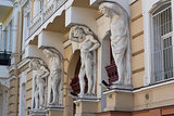 The sculptures supporting designs of a balcony photo