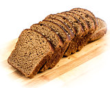 Cut slices of rye bread with caraway seeds on a wooden board