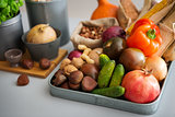 Closeup of Autumn fruits, vegetables, nuts on kitchen counter