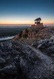 Wooden Tourist Observation Tower over a Landscape at Dusk