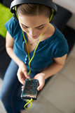 Woman With Green Earphones Listens Podcast Music On Phone
