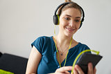 Woman With Green Earphones Listens Podcast Music On Telephone