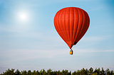 Sigle air balloon in blue sky