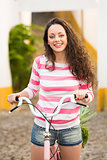 Happy girl riding a bicycle