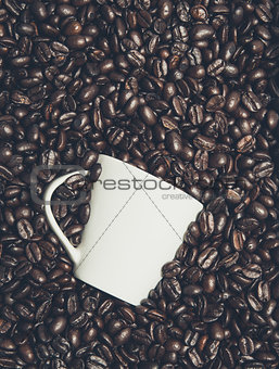 Cup in the coffee beans
