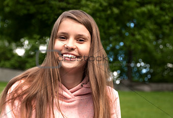 Portrait of happy and smiling teenage girl