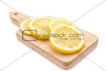 Sliced lemon on cutting board
