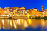 Embankment of river Arno at night, Florence, Italy