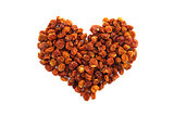 Dried goldenberries in a heart shape