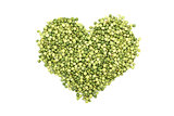 Green split peas in a heart shape