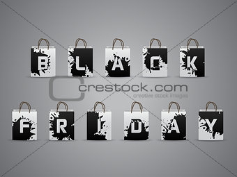 Black friday shopping bags with splattered letters