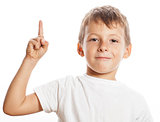 little cute boy pointing in studio isolated close up