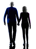 couple senior walking rear view silhouette