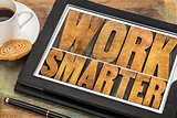 work smarter- wood type text on tablet