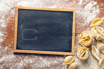 chalkboard and raw pasta