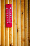 Thermometer heat on wood background