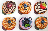Set of different delicious cupcakes in box