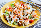 Fresh shrimps, eggs, croutons and vegetables salad