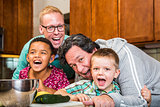 Laughing Family with Gay Dads in Kitchen