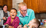 Family with Two Gay Men Laughing
