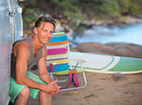 Happy Surfer Sitting at Beach