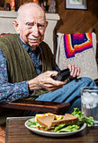 Older Gentleman with Sandwich