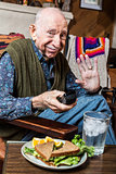 Elderly Man with Sandwich