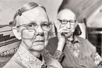 Toned Image of Elderly Couple Sitting in Living Room