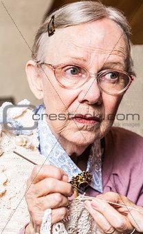 Old Women Crocheting
