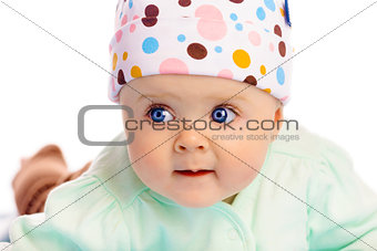 Beautiful baby in the cap. Close-up. Studio photo