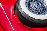 Close up of spare tire on an red retro car