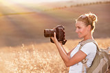Happy photographer enjoying nature