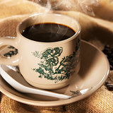 Traditional kopitiam style Chinese coffee in vintage mug