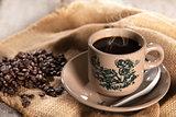 Traditional oriental Hainan coffee in vintage mug