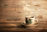 Steaming traditional Chinese coffee in vintage mug and saucer