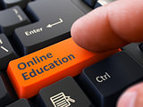 Finger Presses Orange Keyboard Button Online Education.