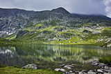 Reflection of Rila Mountain in The Twin lake
