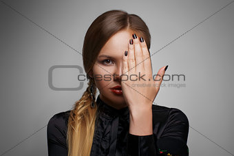 beautiful woman portrait with hand in front of face