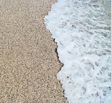 Sea wave and sandy beach