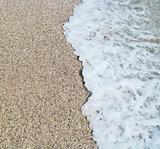 Sea wave and sandy beach