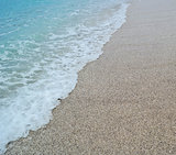 sand beach and blue wave sea