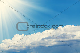 Blue sky, sun and clouds with copy space