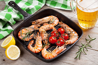 Grilled shrimps on frying pan and beer