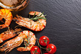 Beer mug and grilled shrimps on stone plate