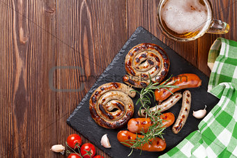 Grilled sausages and beer mug