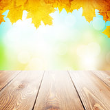 Autumn nature background with maple leaves, wooden table