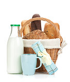 Picnic basket with bread and milk bottle