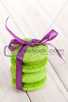 Green macarons with purple ribbon