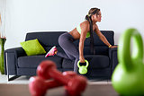 Home Fitness Black Woman Training With Weights On Sofa