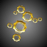 Golden gears on perforated metal background